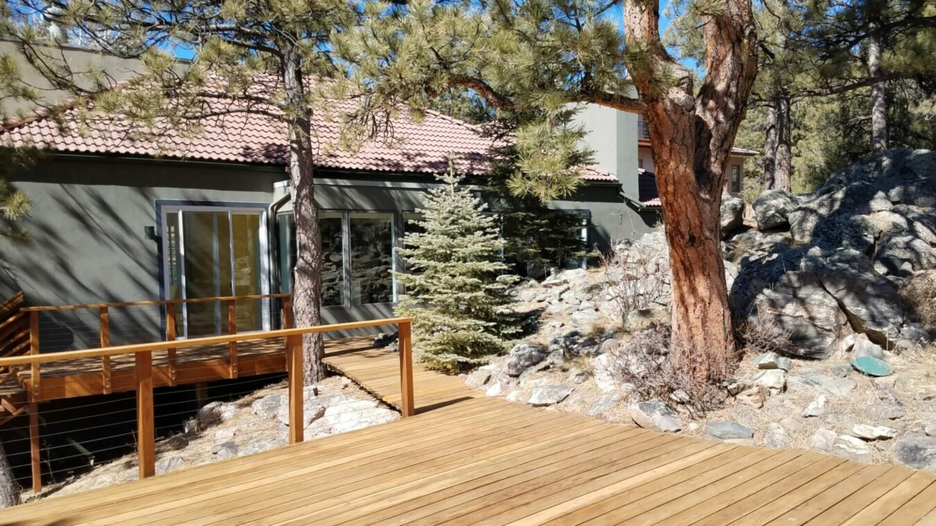 Home with Deck Adjacent Rock Outcrop in Genesee